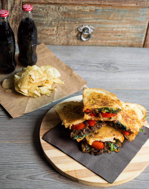 Delicious swiss chard and caramelized balsamic onion grilled cheese sandwich.