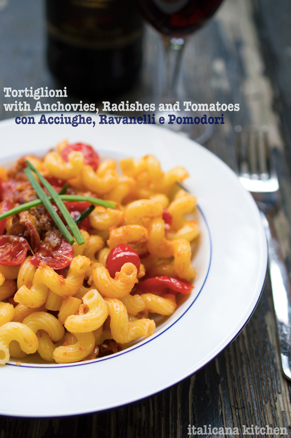 Tortiglioni with anchovies, radishes and tomatoes